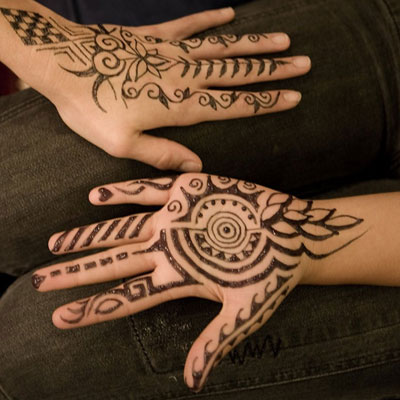 Hands with jagua tattoos