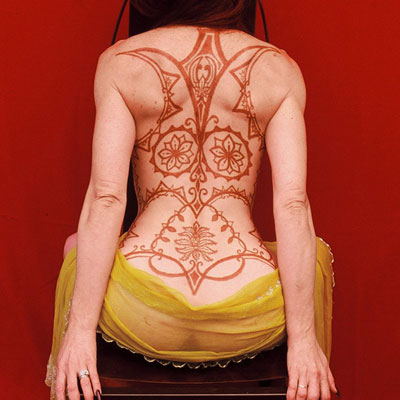 Large henna tattoo on woman's back